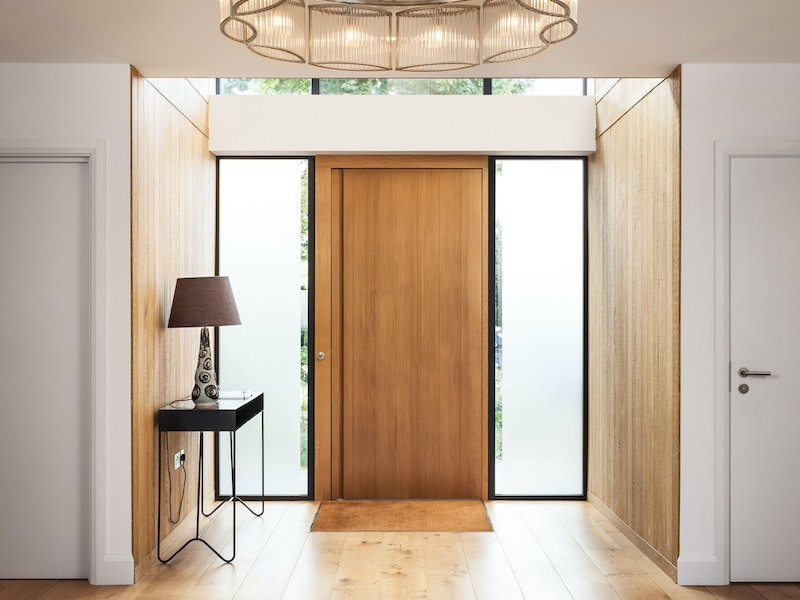 This front door features two glass side panels (side lights)