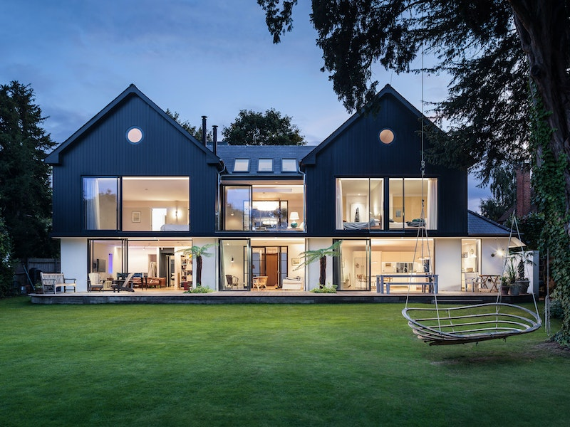 The rear view of the house shows how a wall of glass can light up the interior
