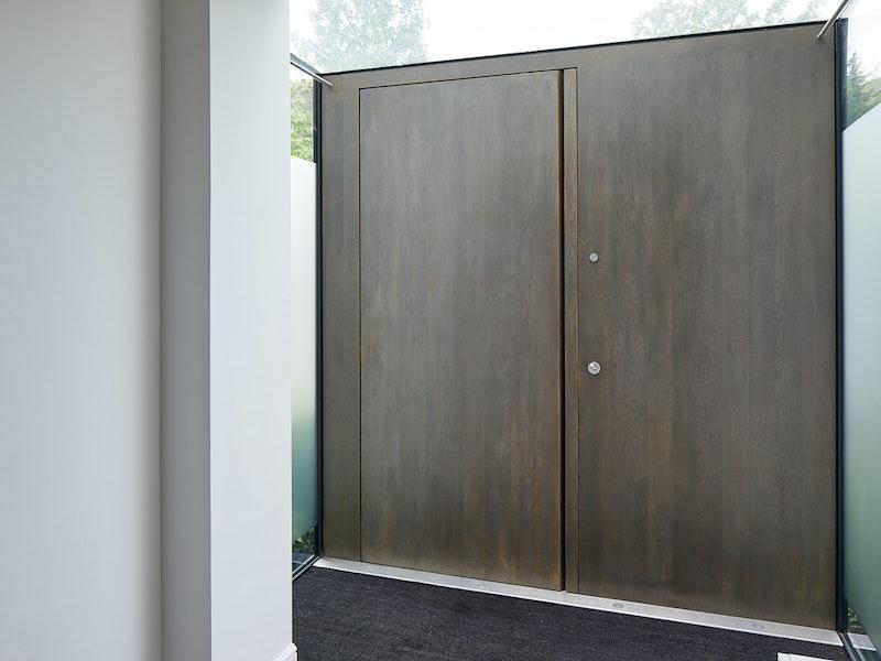 Raw Pivot door set European stained Onyx metallic finish internal view