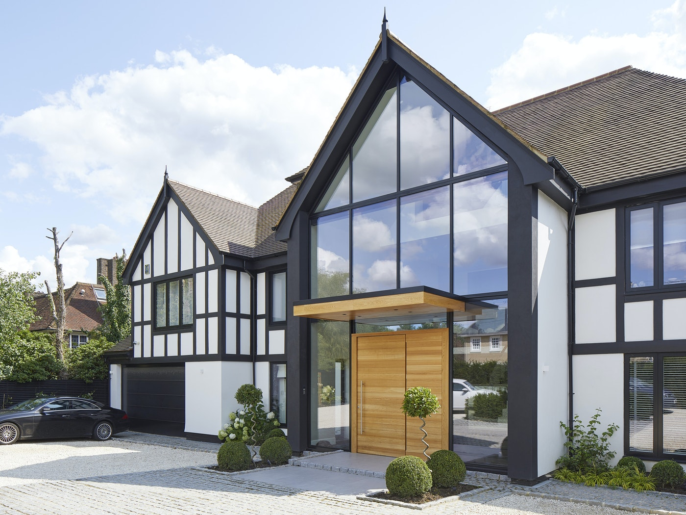 Traditional property with a parma e98 flush pivot door in european oak