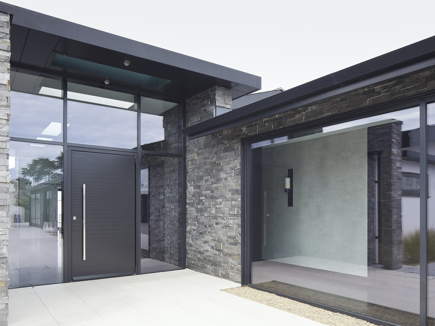 black aluminium glazing works beautifully with the stone cladding
