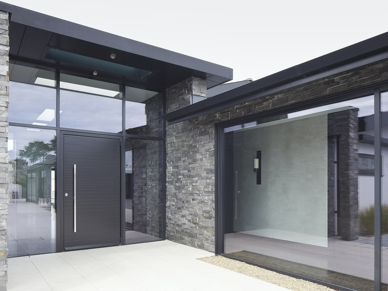 black aluminium glazing works beautifully with the stone cladding