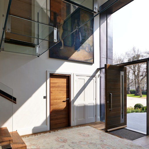 The glass frontage sheds spectacular light on the front and internal doors