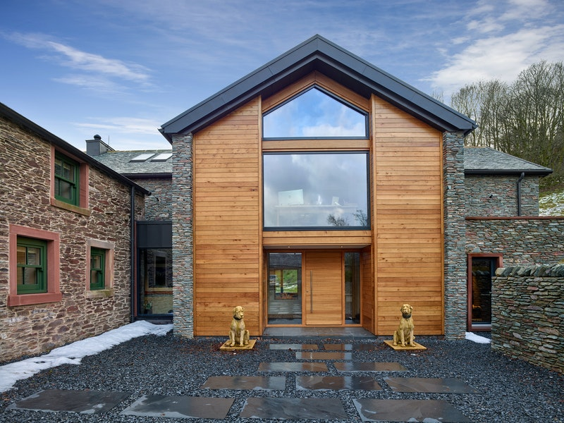 The Milano front door design works well with the wood cladding