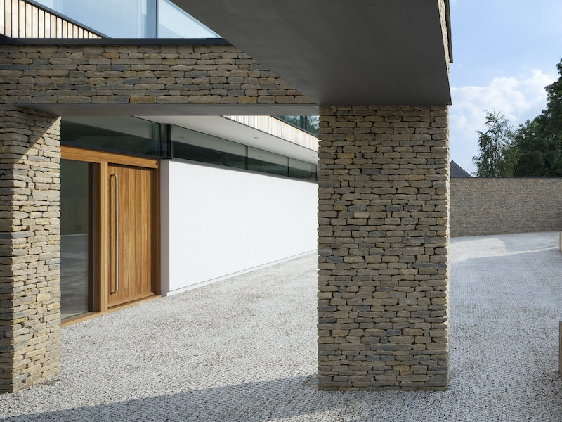 The iroko front door blends well with the different building materials