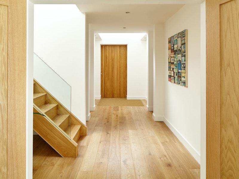Inside, the european oak theme flows throughout this minimalist house