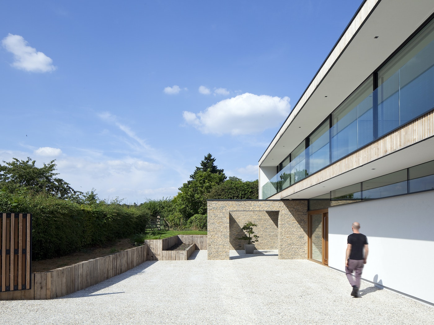 Unusual design details make the external view of this minimalist house extra interesting