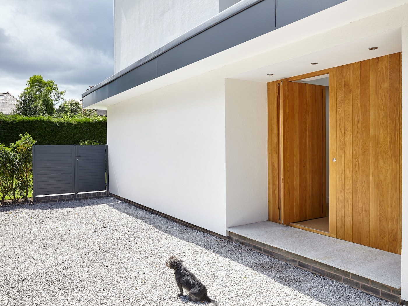 The additional wood side panel gives the impression of a larger entrance