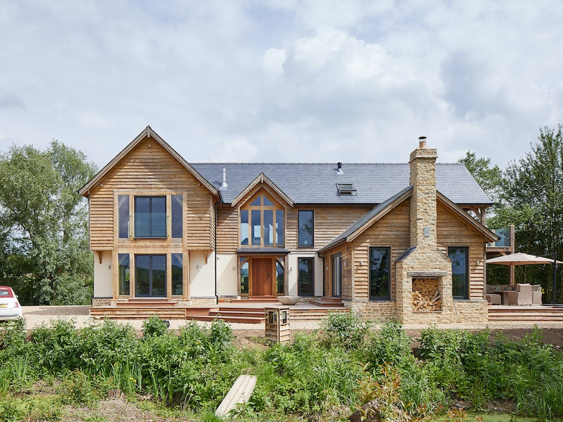Grand but traditional styling - this oak house features an iroko front door by Urban Front