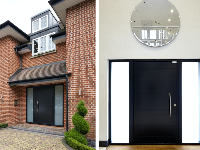 Traditional brick house with Numero black front door