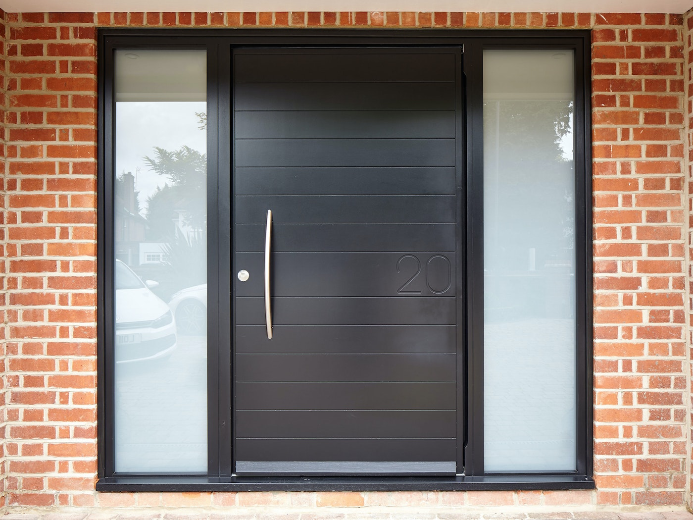 The Numero door design features the house number