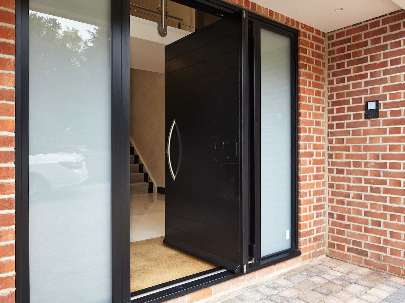The pivot opening style adds to the contemporary look