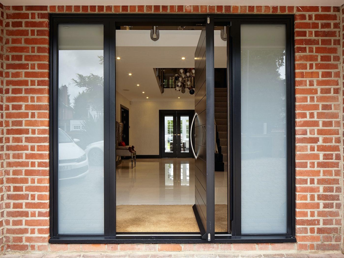 Sandblasted glass side panels add extra interest