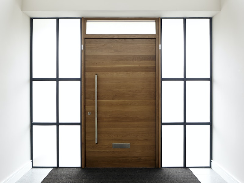 European Oak is fitted into beautiful art deco style glass sidelights