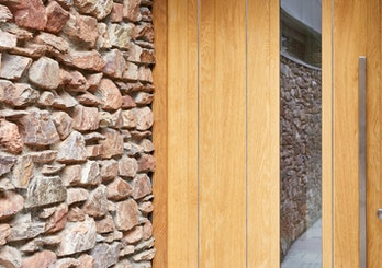 Stainless steel strips expertly contrast with the european oak and exterior stonework