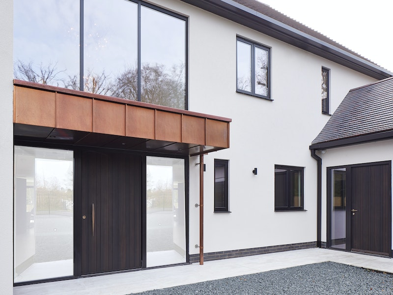 The house features two of our E80 doorsets one as a pivot and one as a side door in a hinged version