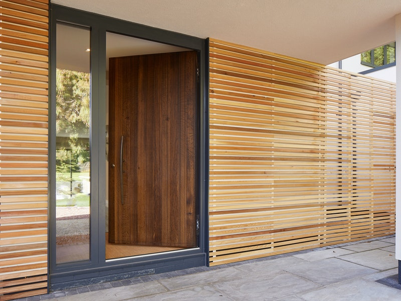 Our Rondo V fumed oak front door has a hinged opening in this house