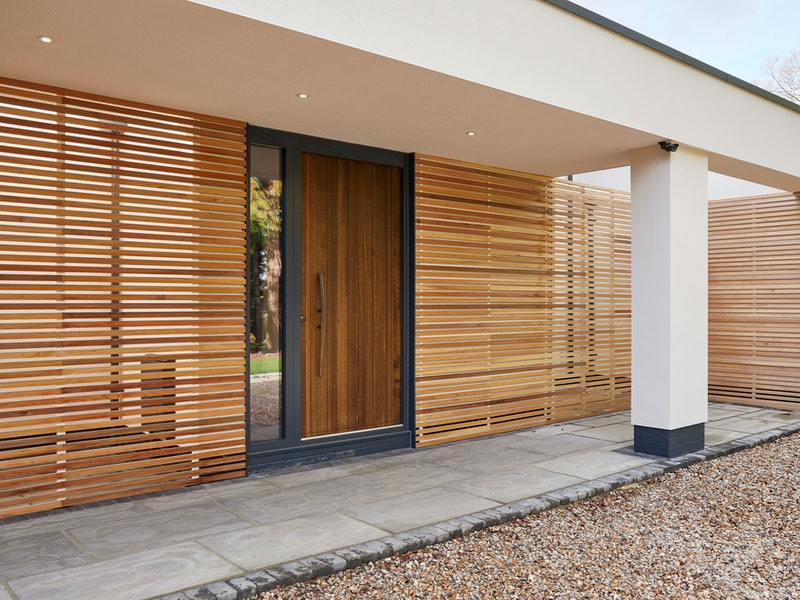 The RAL painted frame works well with the contrasting stone & timber choices