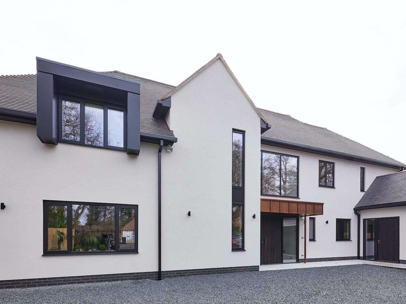 Contemporary house with Rondo V front door in Fumed Oak