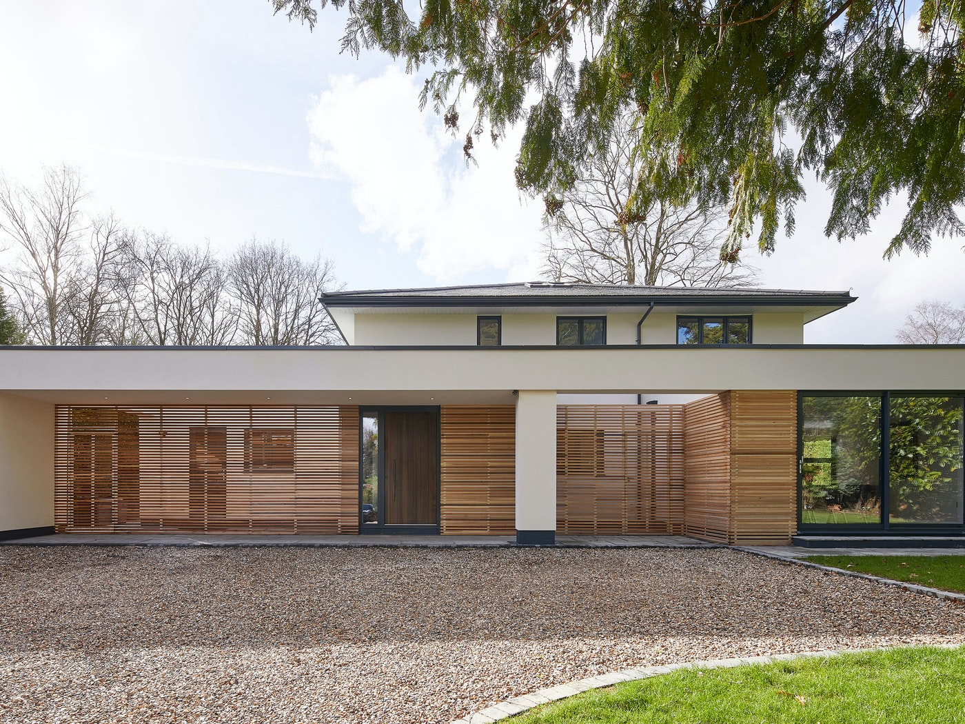 A wonderful example of modern architecture with a fumed oak wood front door