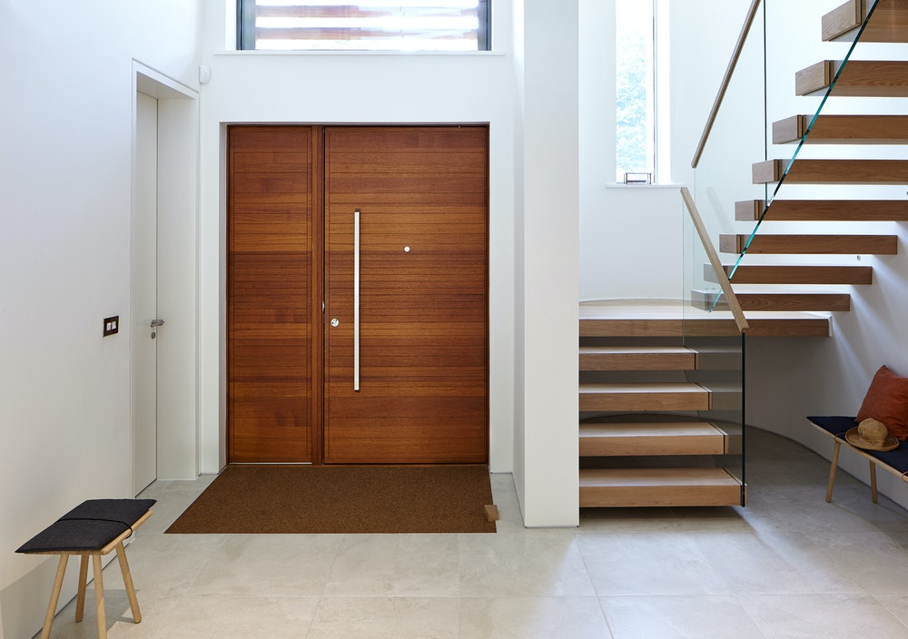 The contemporary front door is matched by the modern interior
