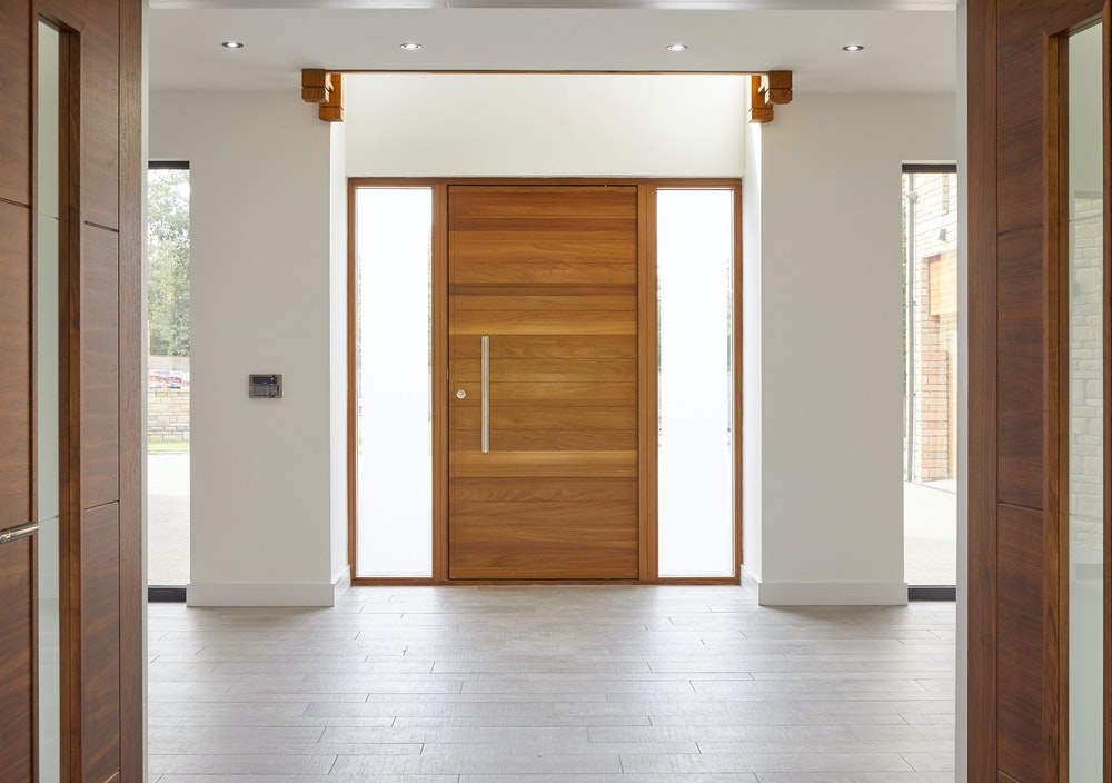 The light modern interior highlights the beauty of the front door