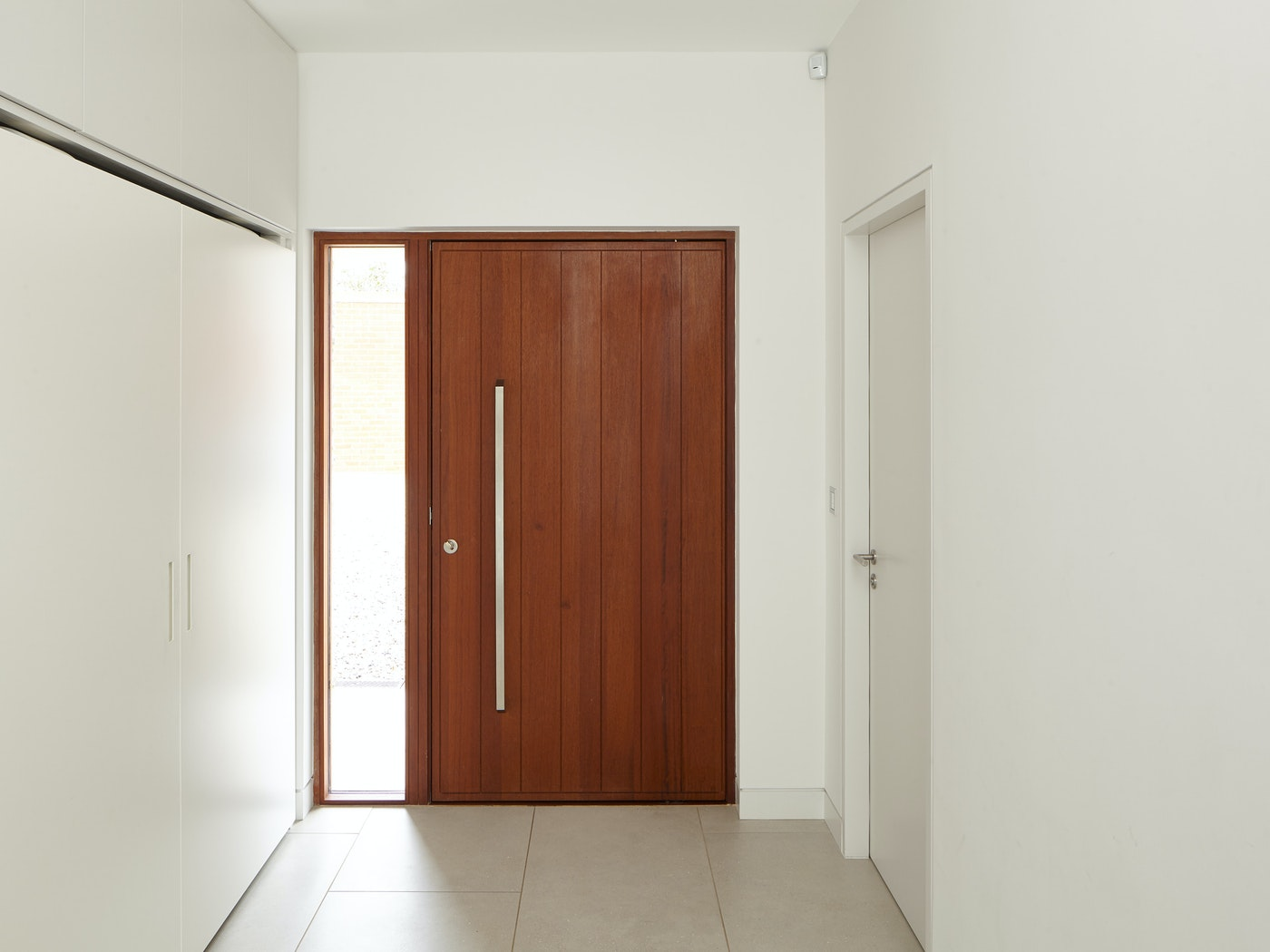 The iroko wood stands out against the all-white interior