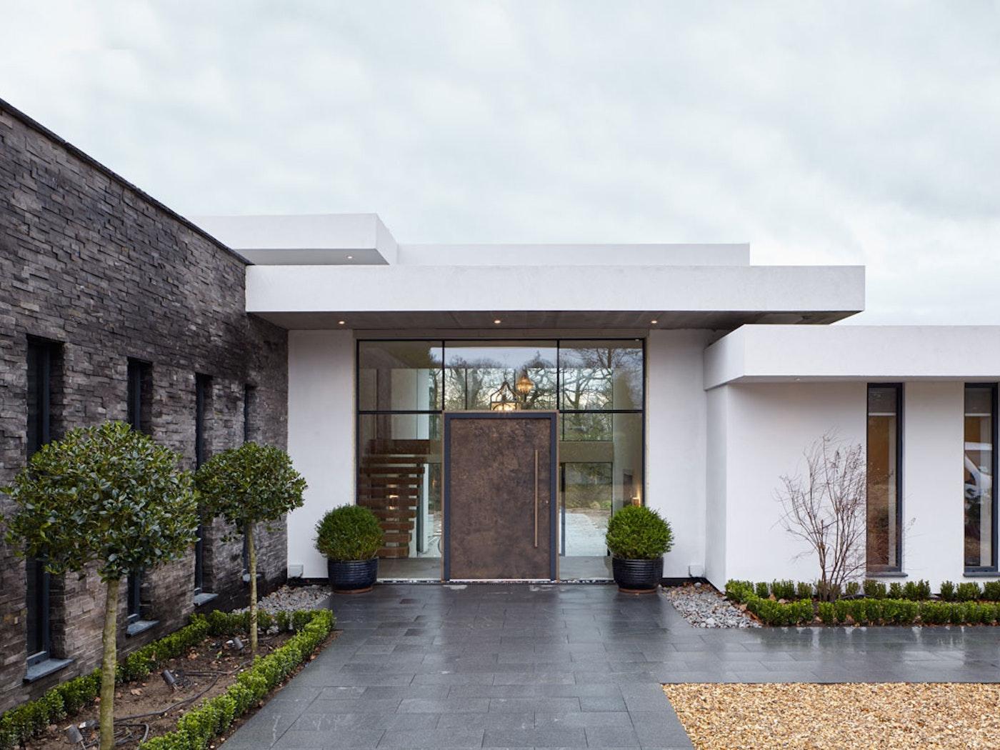Bronze metallic front door in a contemporary house