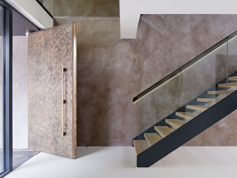Bronze door open, interior staircase | Urban Front