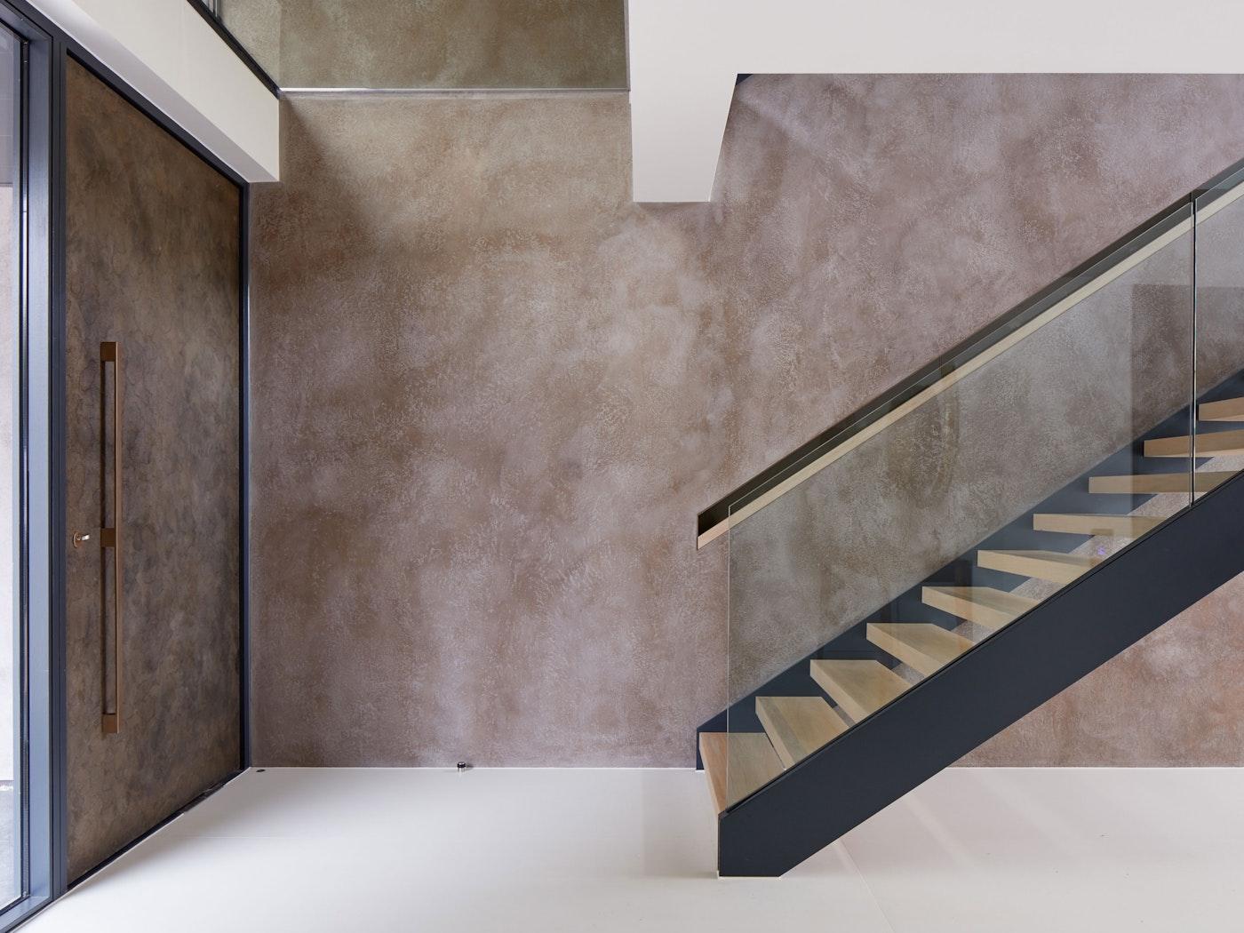Bronze door closed, interior staircase | Urban Front
