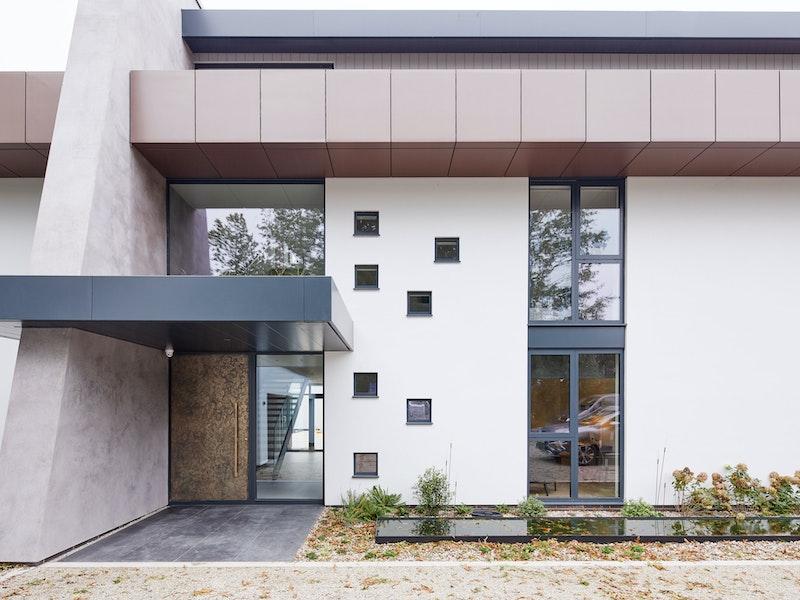 Bronze door exterior facade | Urban Front