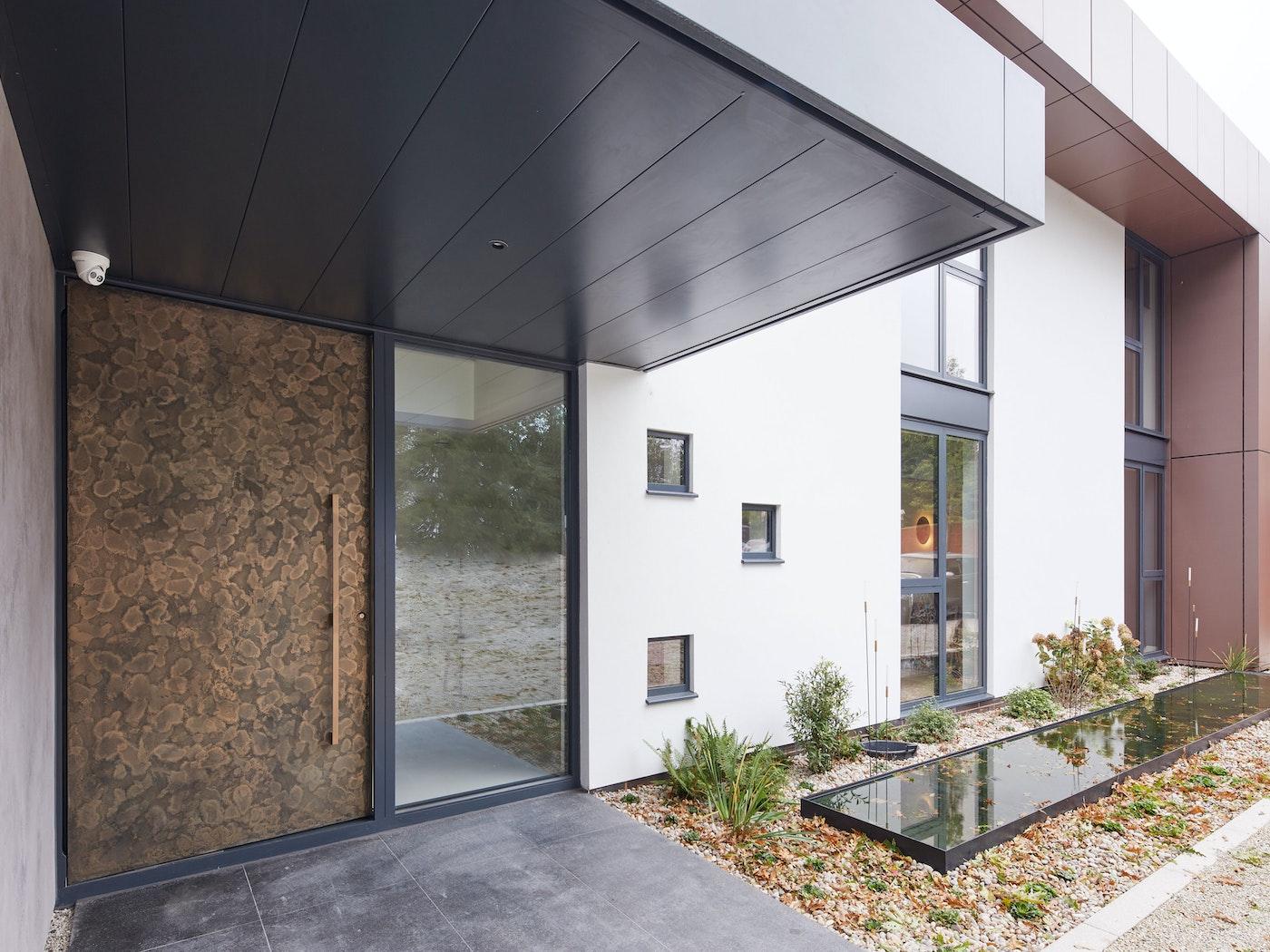Bronze door exterior close up | Urban Front