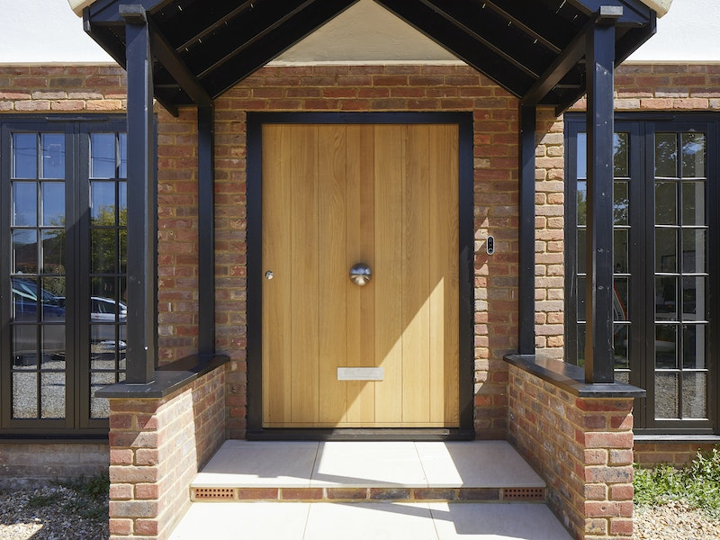 A black frame highlights the standout dimensions of this big entrance door