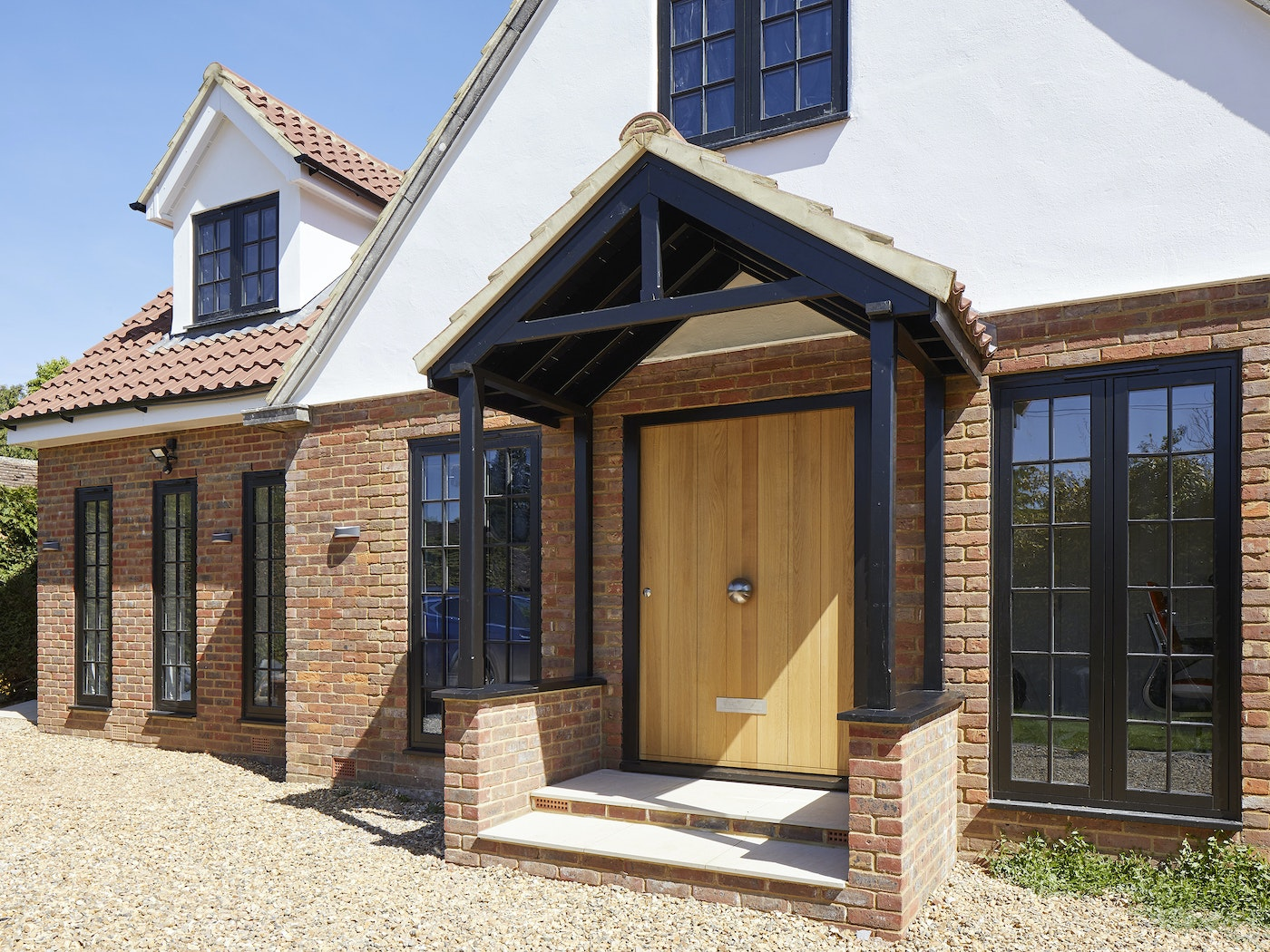 A big front door creates the ultimate welcoming entrance way to your home