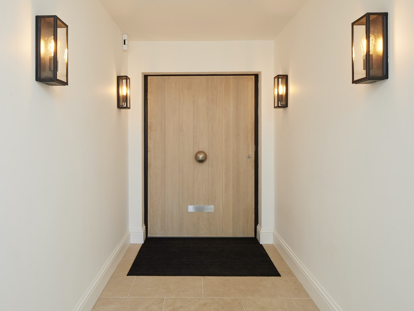A big oak door that is no less eye-catching from the inside view