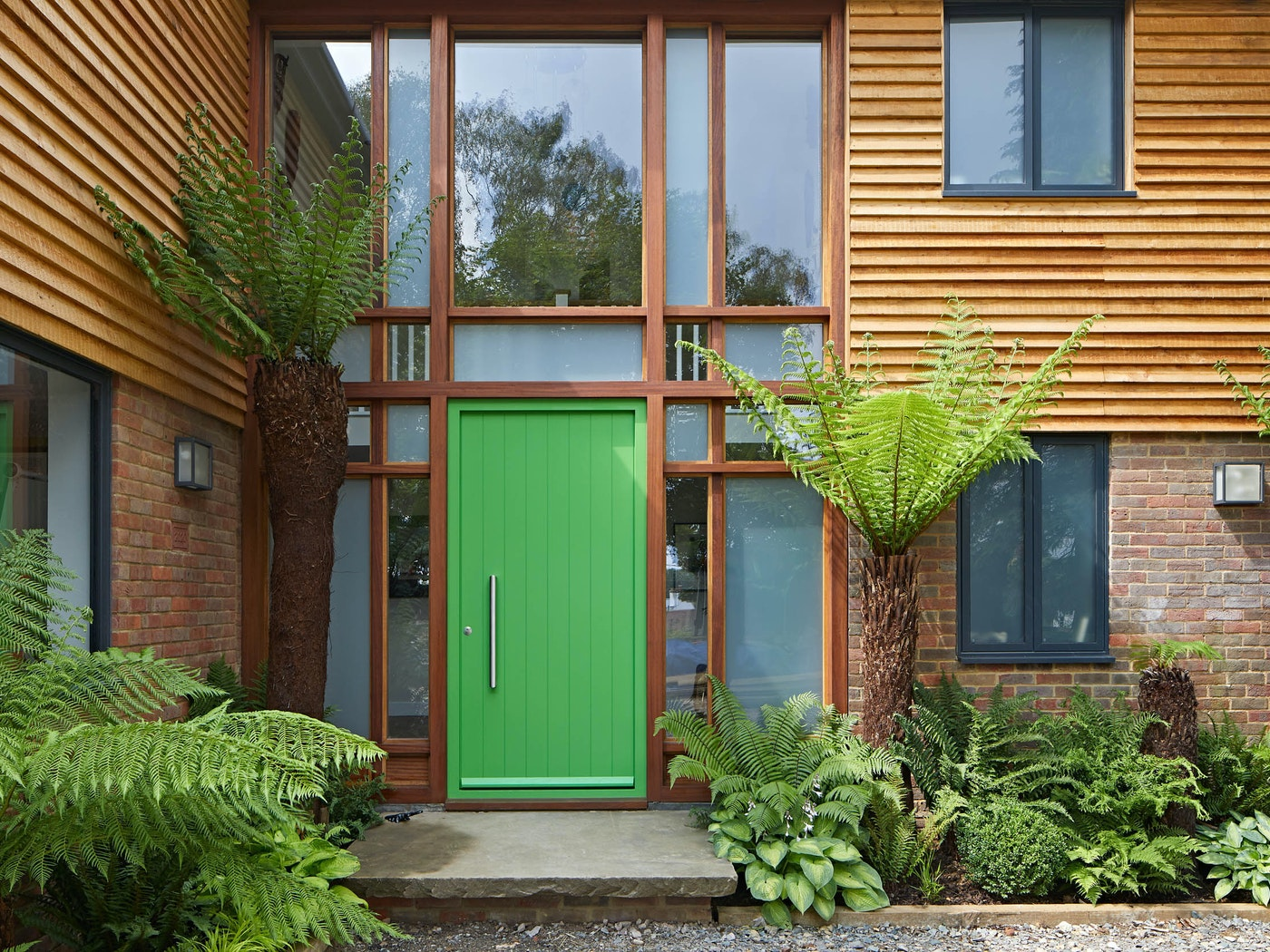 Adding extra interest around the entrance is this glazed curtain walling
