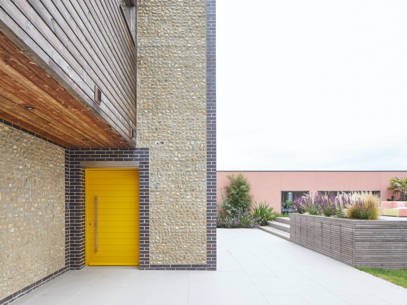 This yellow painted door stands out against the stone facade
