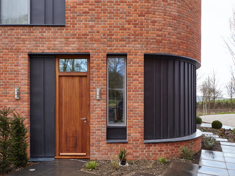 Our Porto front door design in iroko is used across the property