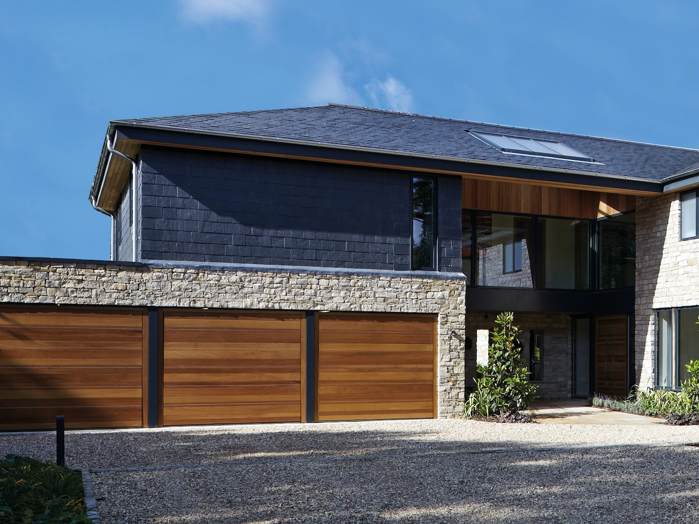 triple up and over garage in iroko with stainless steel inserts