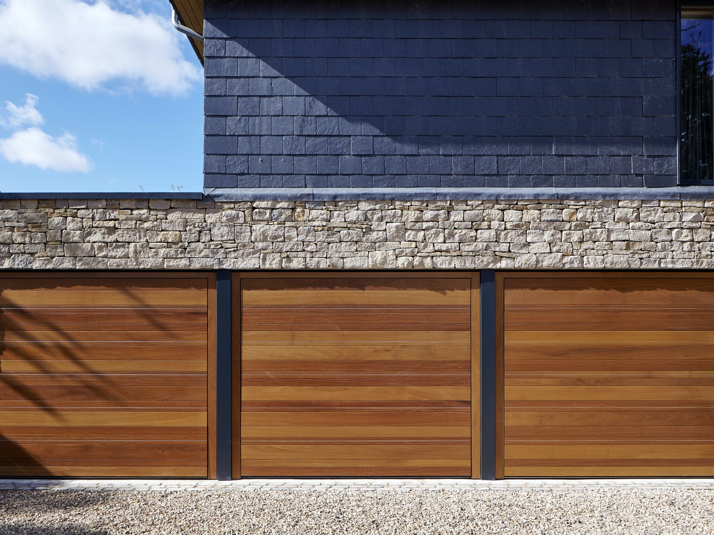 triple garage in iroko with stainless steel inserts