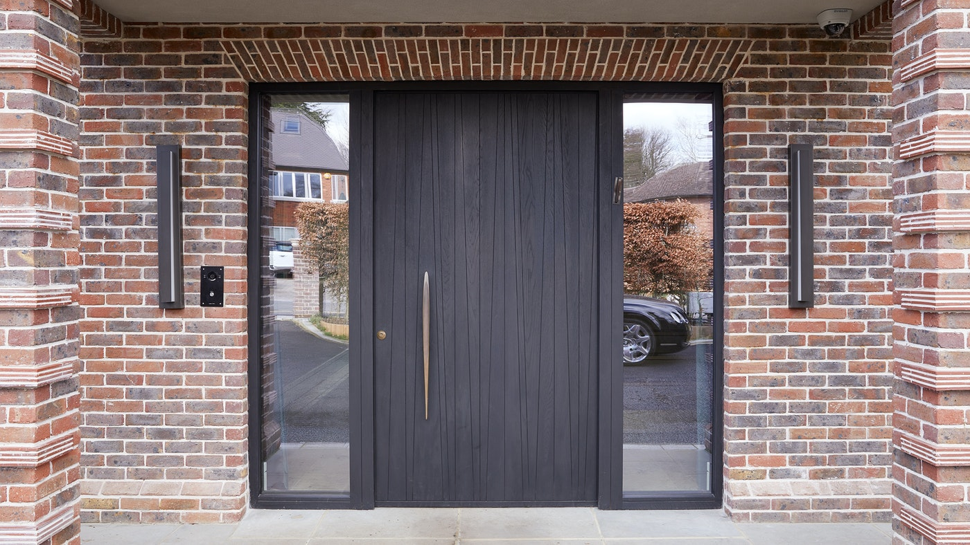European oak timber front door, finished with ebony oil and an elegant bronze handle