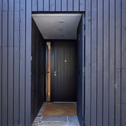 Black front door open | Urban Front