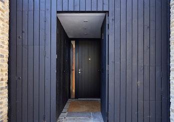 Black front door open | Urban Front