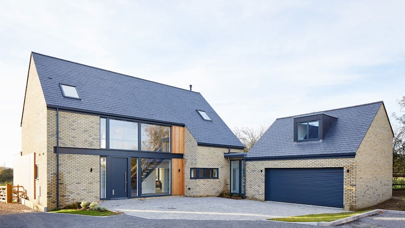 Contemporary front & garage doors in RAL-painted grey