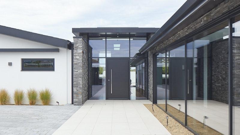 Modern external doors in natural hardwood, painted black
