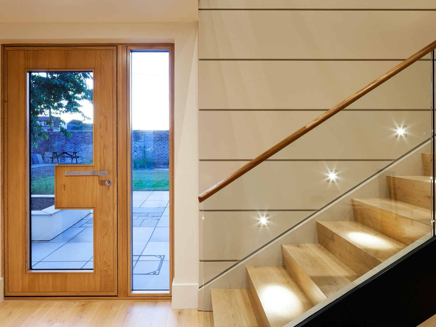 """""""Ice"""" glazed front door in oak, with sidelight in clear glass"""