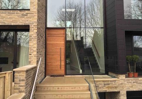 Iroko wood | Matching over panel | Milano front door