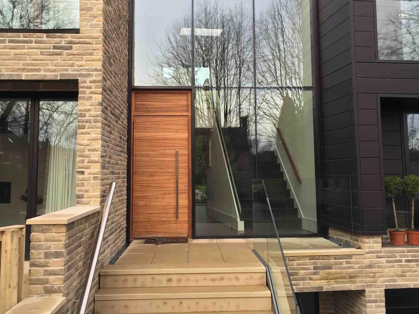 Iroko wood   Matching over panel   Milano front door