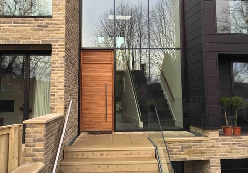 Iroko wood | Matching over panel | Milano front door