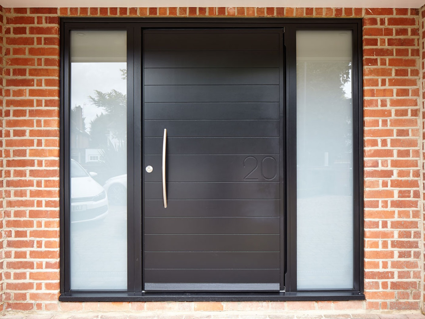 Numero front door | Black painted | Horizontal grooves | Urban Front